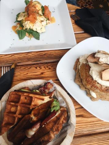 Bacon and avocado waffle sandwich, carrot cake pancakes and salmon eggs benny from Alsur Café, Barcelona, Spain. Source: Savannah Hamelin